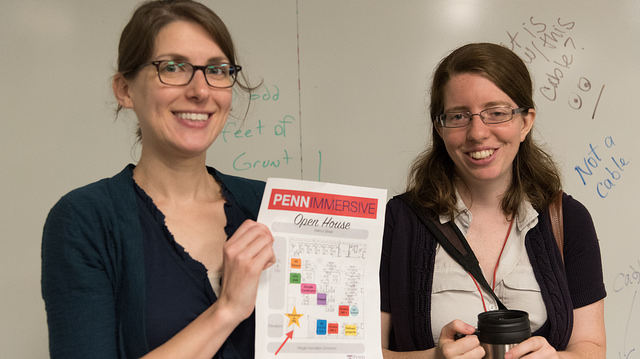 Patty & Sasha hold up PennImmersive flyer 2017