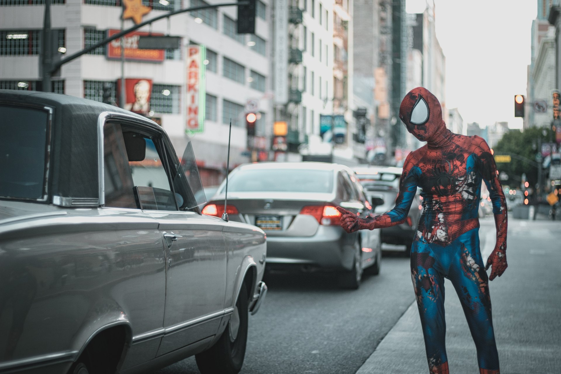 Man wearing Spiderman outfit in city